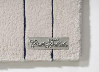Christian-Fischbacher-Teppich-Lines-Merinowolle-rosé-nachtblau